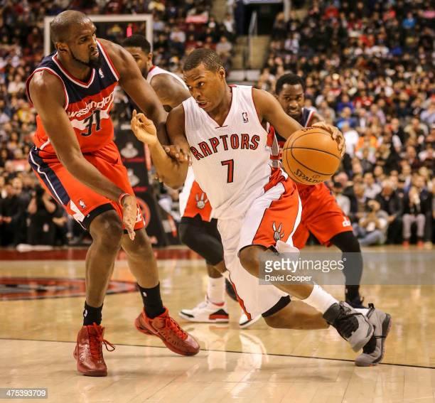 TORONTO ON FEBRUARY 27 Toronto Raptors point guard Kyle Lowry heads around Washington Wizards small forward Chris Singleton on the way to the basket...