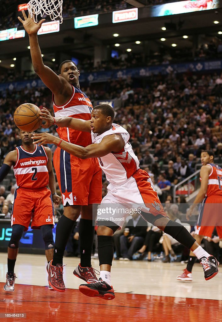 Toronto Raptors point guard Kyle Lowry (3) sneaks a pass aroundKevin Seraphin in second half action as the Toronto Raptors beat the Washington Wizards 88-78 at the Air Canada Centre in Toronto.