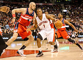 TORONTO ON FEBRUARY 27 Toronto Raptors point guard Kyle Lowry tries to get by Washington Wizards center Marcin Gortat during the game between the...