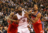 TORONTO ON FEBRUARY 27 Toronto Raptors power forward Amir Johnson battle for position with Washington Wizards power forward Trevor Booker and Wizards...
