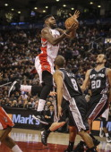 TORONTO ON DECEMBER 10 Toronto Raptors power forward Amir Johnson flies high but misses and recovers and stuffs his own rebound as the Toronto...