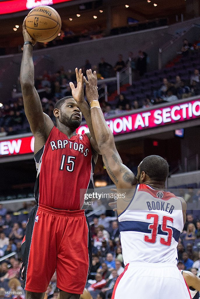 Toronto Raptors power forward Amir Johnson (15) shoots over Washington Wizards power forward Trevor Booker (35) during the first half of their game played at the Verizon Center in Washington, D.C., Tuesday, February 19, 2013.