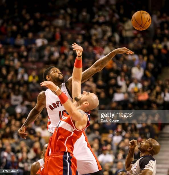 TORONTO ON FEBRUARY 27 Toronto Raptors power forward Amir Johnson swats the ball away from Washington Wizards center Marcin Gortat during the game...