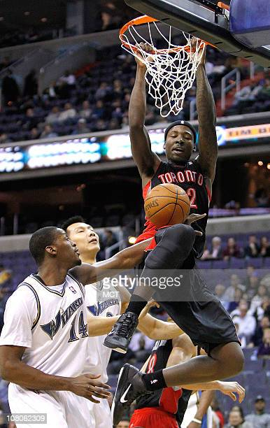 Toronto Raptors power forward Ed Davis slam dunks over Washington Wizards small forward Al Thornton during their game played at the Verizon Center in...