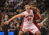 TORONTO ON DECEMBER 13 Toronto Raptors power forward Tyler Hansbrough boxes out Philadelphia 76ers power forward Lavoy Allen during his first game as...