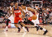 TORONTO ON FEBRUARY 27 Toronto Raptors shooting guard DeMar DeRozan drives to the basket past Washington Wizards small forward Trevor Ariza during...