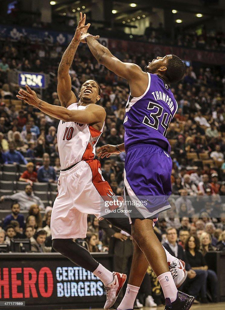 TORONTO ON MARCH 7 Toronto Raptors shooting guard DeMar DeRozan looks past Sacramento Kings power forward Jason Thompson towards the basket during...