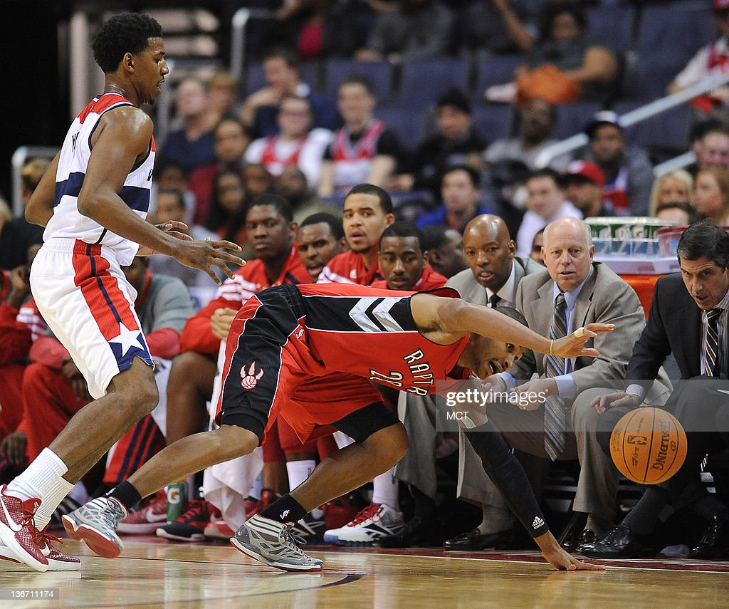 Toronto Raptors shooting guard Leandro Barbosa (20) tries to save a loose ball against Washington Wizards shooting guard Nick Young (1), left, during third-quarter action at the Verizon Center in Washington, D.C., Wednesday, January 10, 2012. The Wizards defeated the Raptors, 93-78.