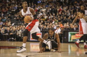 TORONTO ON DECEMBER 10 Toronto Raptors shooting guard Terrence Ross recovers a loose ball in front of San Antonio Spurs small forward Kawhi Leonard...