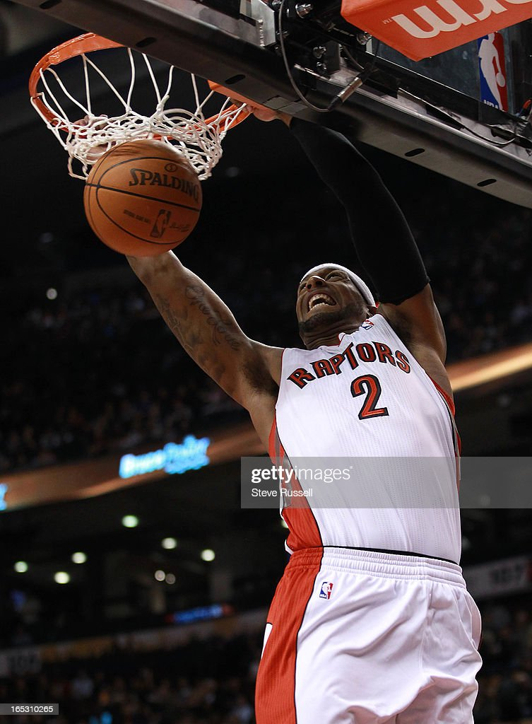 Toronto Raptors small forward James Johnson dunks as the Toronto Raptors play in their first preseason game against the Boston Celtics at the Air...