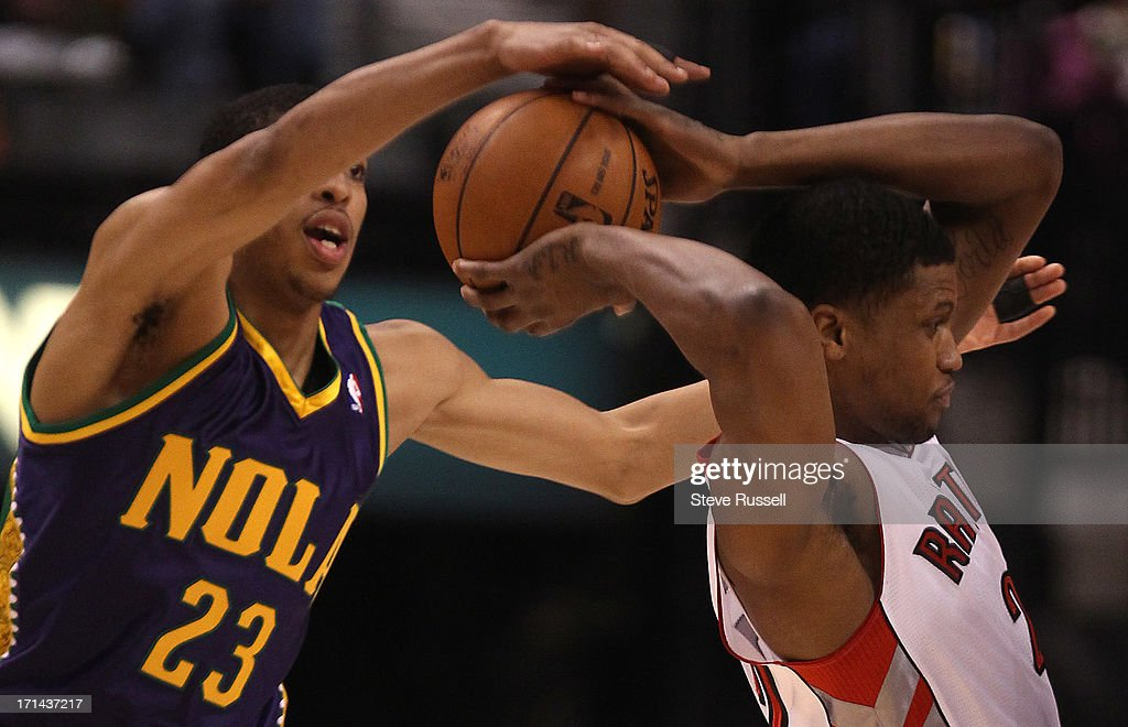 Toronto Raptors small forward Rudy Gay gets a pass of despite New Orleans Hornets power forward Anthony Davis defending as the Toronto Raptors play...