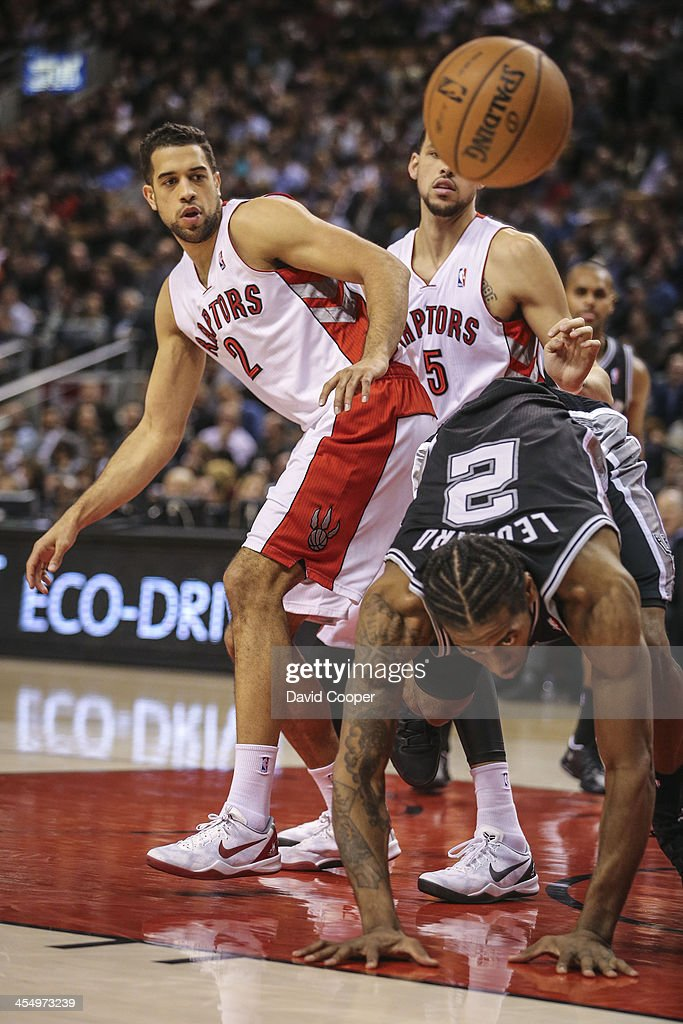 TORONTO ON DECEMBER 10 Toronto Raptors small forwards Landry Fields and Austin Daye look for the loose ball over San Antonio Spurs small forward...