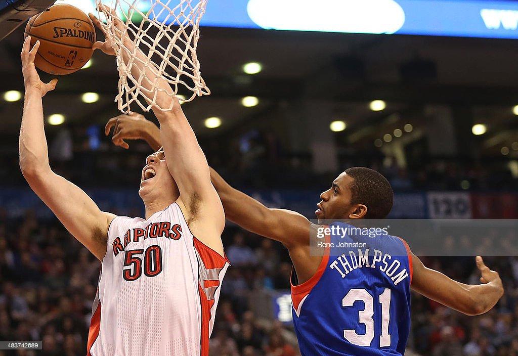 TORONTO, ON -APRIL 9 - Toronto Raptors Tyler Hansborough gets fouled by Hollis Thompson of the Philadelphia 76ers in the first half. Toronto, April 9, 2014.