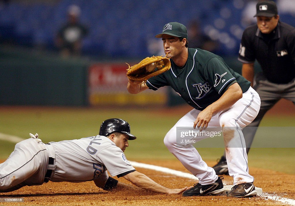 Toronto shortstop <a gi-track='captionPersonalityLinkClicked' href=/galleries/search?phrase=John+McDonald+-+Baseball+Player&family=editorial&specificpeople=215395 ng-click='$event.stopPropagation()'>John McDonald</a> slides safely back to first as Tampa Bay's <a gi-track='captionPersonalityLinkClicked' href=/galleries/search?phrase=Travis+Lee+-+Baseball+Player&family=editorial&specificpeople=590335 ng-click='$event.stopPropagation()'>Travis Lee</a> takes the throw during Wednesday night's action at Tropicana Field in St. Petersburg, Florida on August 16, 2006.