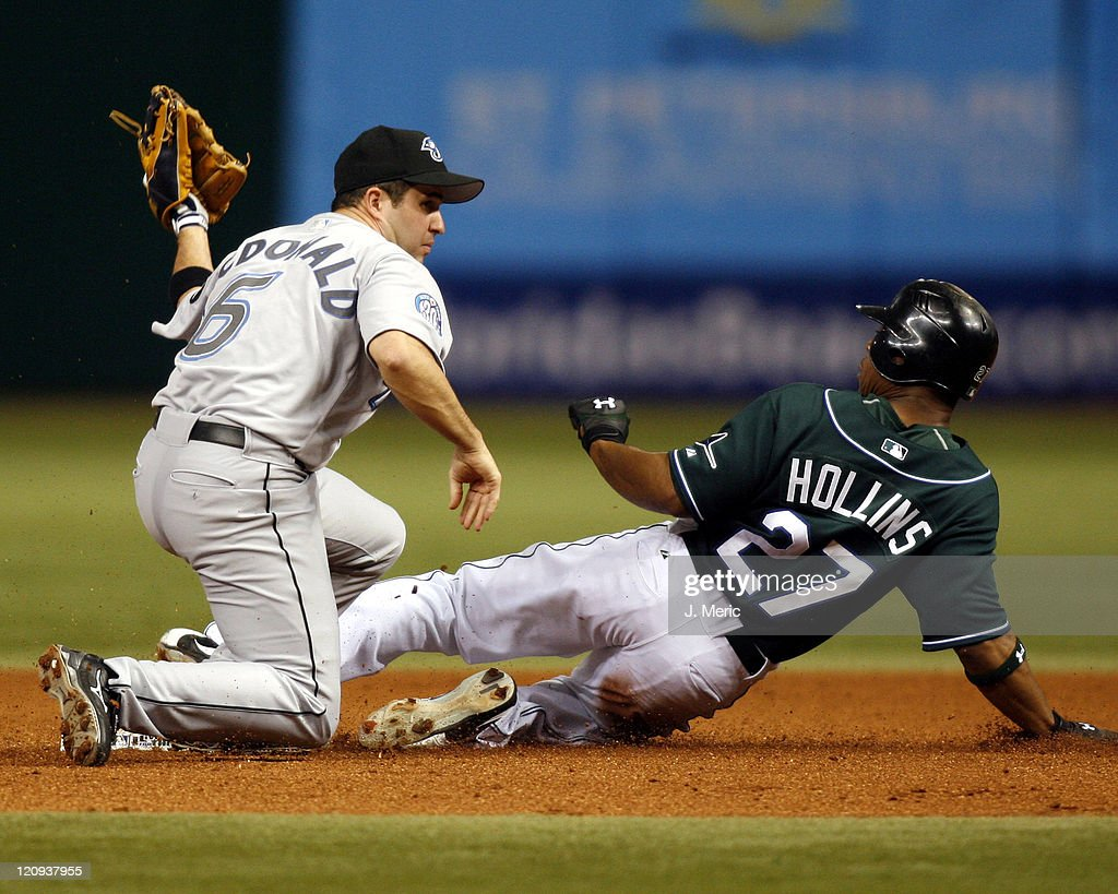 Toronto shortstop <a gi-track='captionPersonalityLinkClicked' href=/galleries/search?phrase=John+McDonald+-+Baseball+Player&family=editorial&specificpeople=215395 ng-click='$event.stopPropagation()'>John McDonald</a> tags out Tampa Bay's Damon Hollins as he attempts to steal second during Friday night's action at Tropicana Field in St. Petersburg, Florida on May 12, 2006.