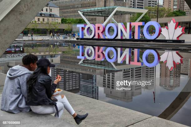 Toronto sign illuminated with the colours of the United Kingdom flag on May 23 in Toronto Canada as a tribute to victims of the terror attack carried...