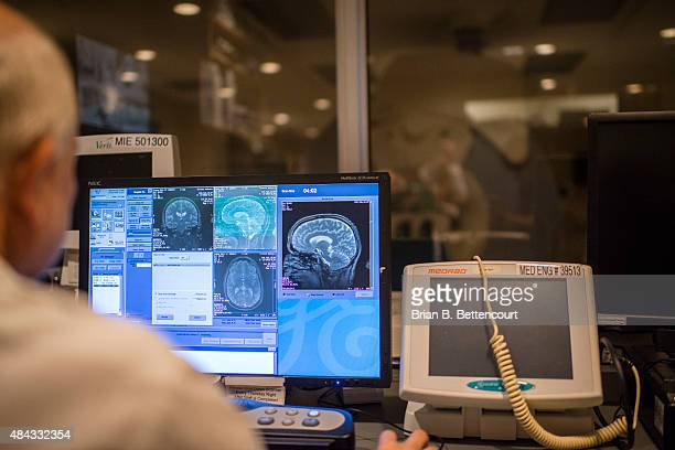 Toronto Star reporter Joe Hall's brain scan images taken during his visit to the Toronto Western Hospital's MRI room on July 29 2015 A machine called...