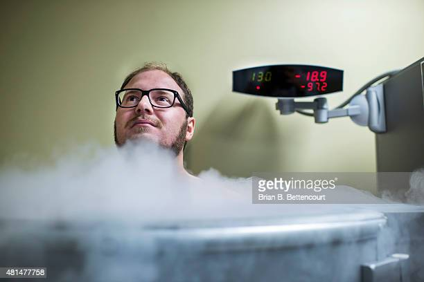 Toronto Star reporter Michael Robinson sits inside a cryotherapy machine at the Cryotherapy Health and Wellness facility on July 17 2015 The three...