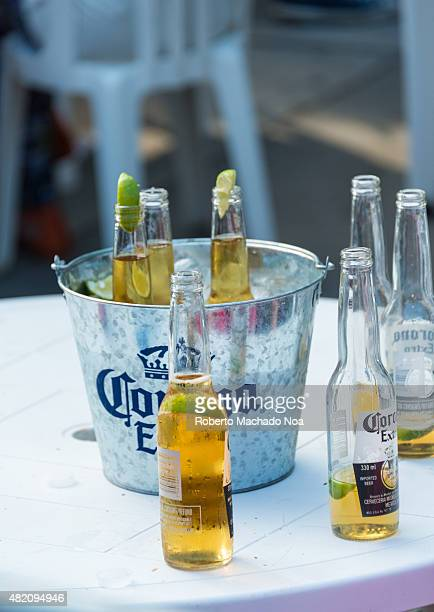Toronto street festivals Corona Extra at Taste of Little Italy festival Three bottles of beer sit in a silver bucket of ice Three more are sitting on...