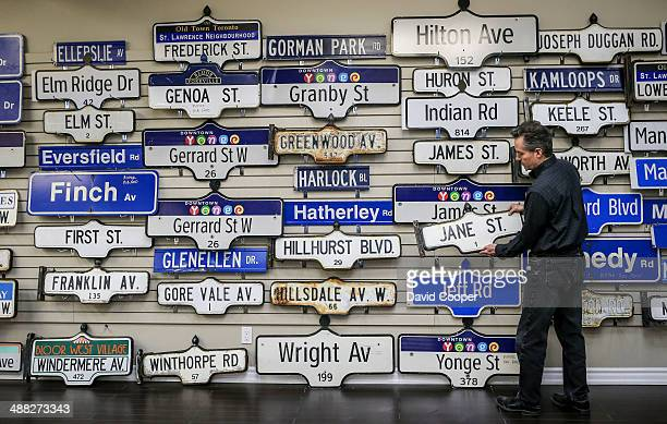 Toronto Street Signs are on display at Platinum Liquidations John Farquharson General Manager at Platinum Liquidations holds a Jane St sign from the...