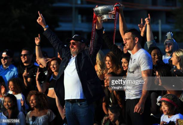 Toronto Wolfpack Chairman David Argyle and Captain Craig Hall lift the Championship 1 Promotion Trophy after victory over Barrow Raiders following a...