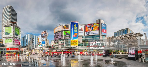 Toronto Yonge Dundas Square crowds fountains colourful billboards panorama Canada