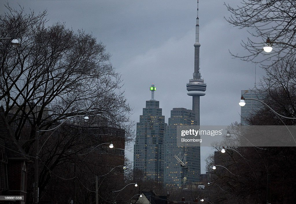 Toronto-Dominion Bank's TD Canada Trust Tower, left, stands with the CN Tower in the skyline of Toronto, Ontario, Canada, on Wednesday, April 10, 2013. The Canadian dollar fluctuated against its U.S. counterpart amid speculation the economy is slowing after an unexpected jobs loss last month. Photographer: Pawel Dwulit/Bloomberg via Getty Images