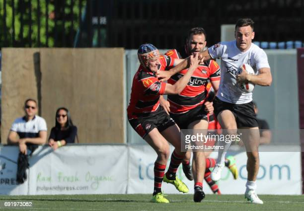 TORONTO ON JUNE 3 Toronto's Craig Hall fights off several Coventry players and goes for a run Canada's first professional rugby team the Toronto...