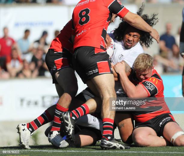 TORONTO ON JUNE 3 Toronto's Fui Fui Moi Moi battles 4 coventry players who work on bringing him down Canada's first professional rugby team the...