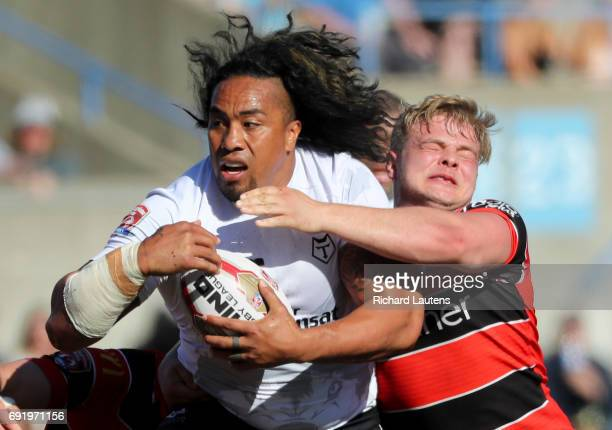TORONTO ON JUNE 3 Toronto's Fui Fui Moi Moi fights off the tackle of Coventry's Eddie Medford Canada's first professional rugby team the Toronto...