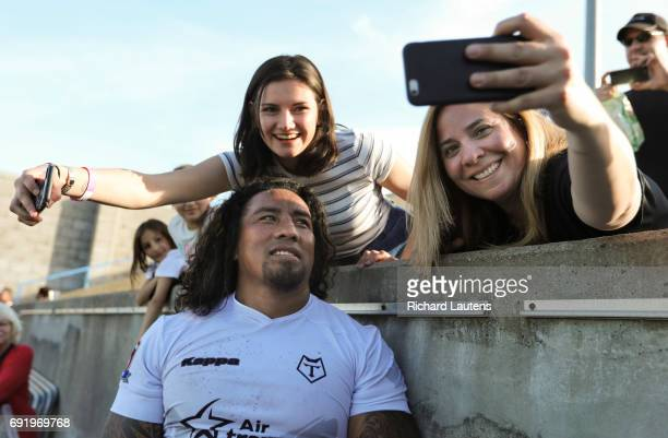 TORONTO ON JUNE 3 Toronto's Fui Fui Moi Moi poses for photos with fans after the match Canada's first professional rugby team the Toronto Wolfpack...