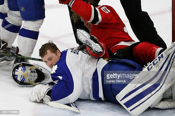 TORONTO ON MAY Toronto's goalie Antoine Bibeau loses his helmet to a sprawling Ben Thomson during second period action The Toronto Marlies hosted the...