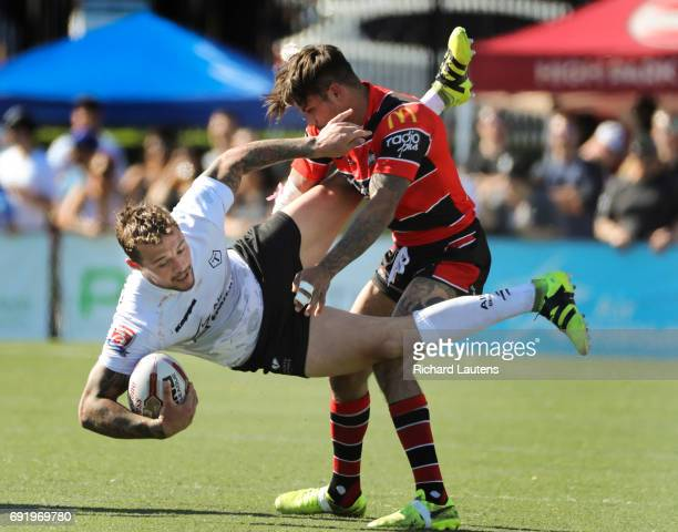 TORONTO ON JUNE 3 Toronto's Gregory Worthington goes down at the hands of Brad Delaney in first half action Canada's first professional rugby team...