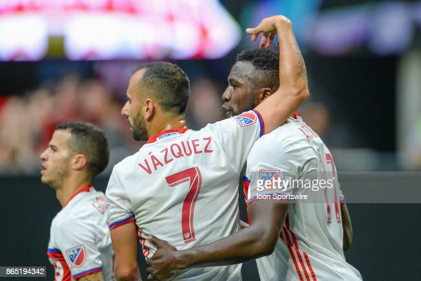 Toronto's Jozy Altidore is congratulated by Victor Vazquuez after scoring a goal during a match between Atlanta United and Toronto FC on October 22...