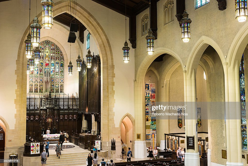 Toronto's Metropolitan United Church is a large neo-Gothic church. In the picture people are visiting the church after a Sunday service. Toronto Metropolitan Church is one of the largest and most prominent churches of the United Church of Canada.