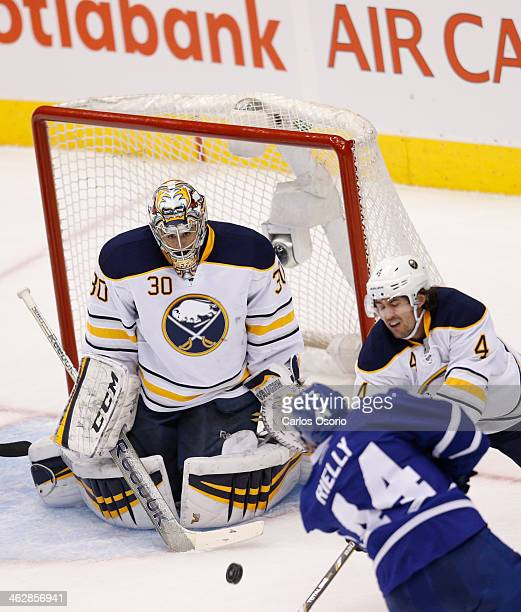 TORONTO ON JANUARY 15 Toronto's Morgan Rielly scores on Buffalo goalie Ryan Miller during the 2nd period of NHL action as the Toronto Maple Leafs...