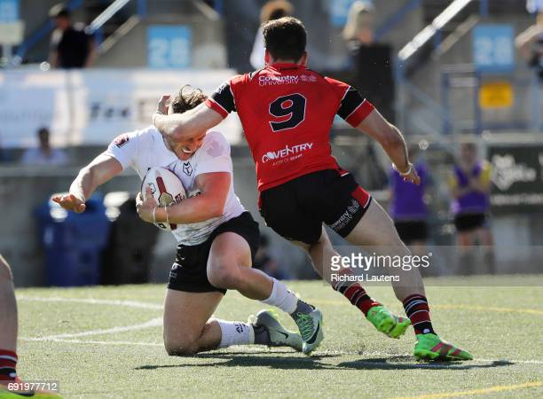 TORONTO ON JUNE 3 Toronto's Rhys Jacks gets tackled around his head by Coventry's Jay Lobwein Canada's first professional rugby team the Toronto...