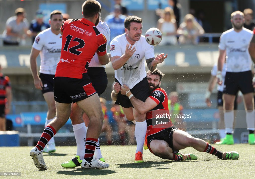 TORONTO, ON - JUNE, 3 Toronto's Sean Penkywicz passes the ball as he gets tackled. Canada's first professional rugby team the Toronto Wolfpack beat the Coventry Bears 56-12 in English Rugby Football League action at Lamport Stadium in Toronto. June 3, 2017 Richard Lautens/Toronto Star