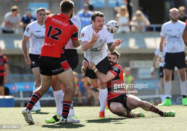 TORONTO ON JUNE 3 Toronto's Sean Penkywicz passes the ball as he gets tackled Canada's first professional rugby team the Toronto Wolfpack beat the...