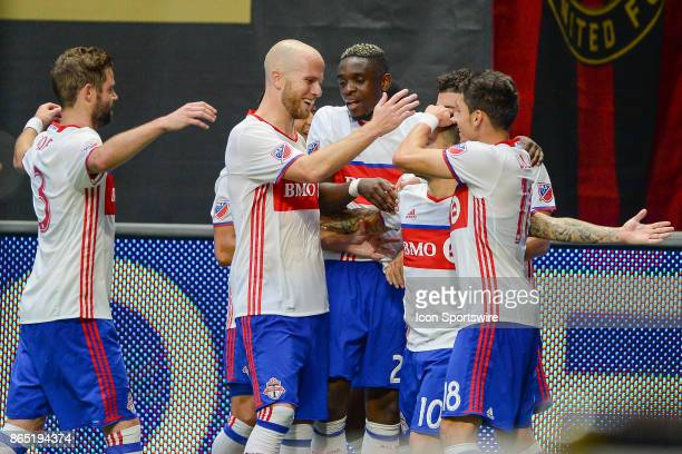 Toronto's Sebastian Giovinco is mobbed by teammates after scoring a goal during a match between Atlanta United and Toronto FC on October 22 2017 at...