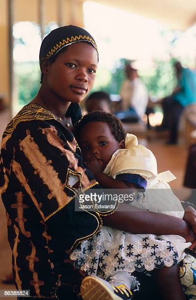 A beautiful African woman and her child wait for a doctors appointment