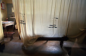 A barren HIV AIDS examination ward in a rural East African hospital.