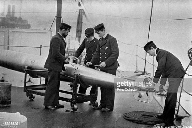 Torpedo instruction on board HMS 'Theseus' 1896 Four sailors with a Whitehead torpedo The 'Theseus' was a cruiser launched in 1892 The selfpropelled...