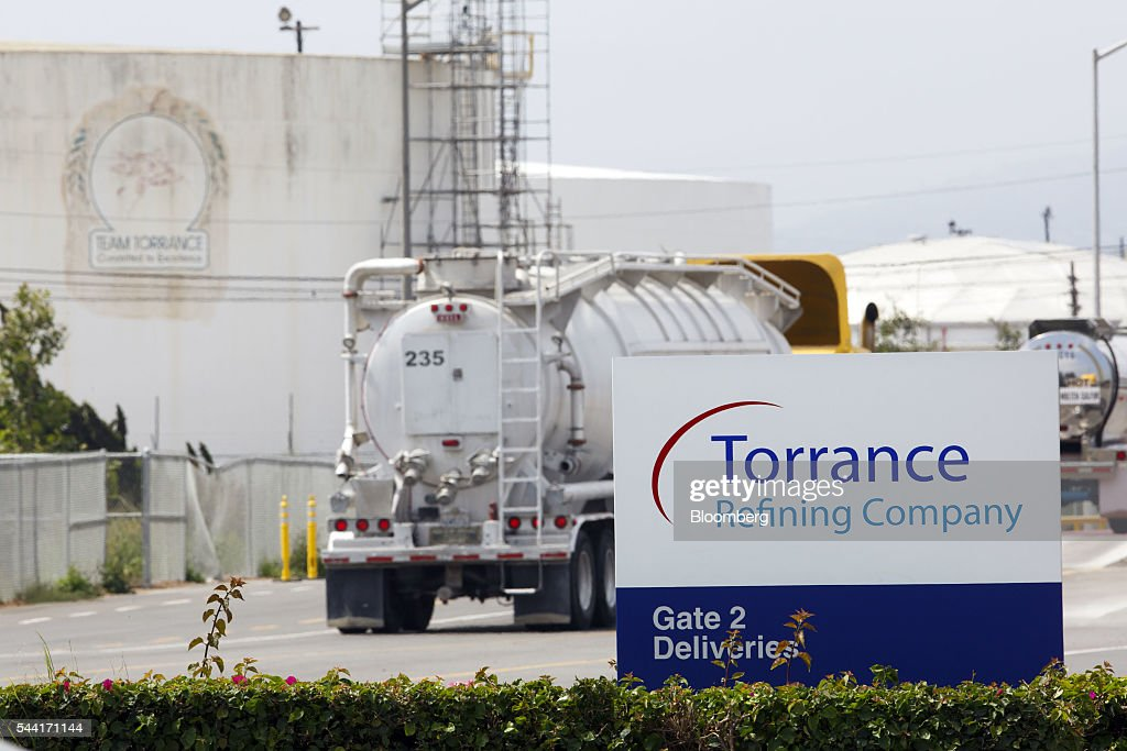Torrance Refining Co. signage is displayed as trucks enter the oil refinery in Torrance, California, U.S., on Friday, July 1, 2016. Exxon Mobil Corp. completed the sale of the Torrance refinery to PBF Energy on July 1. Photographer: Patrick T. Fallon/Bloomberg via Getty Images