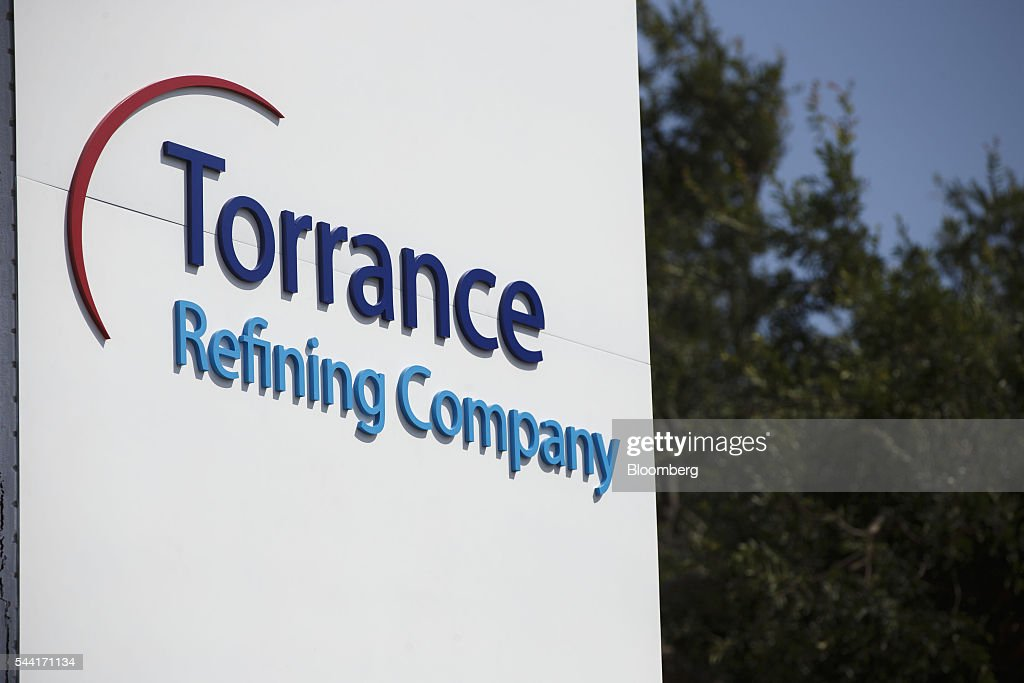 Torrance Refining Co. signage is displayed outside of the oil refinery in Torrance, California, U.S., on Thursday, June 30, 2016. Exxon Mobil Corp. completed the sale of the Torrance refinery to PBF Energy on July 1. Photographer: Patrick T. Fallon/Bloomberg via Getty Images