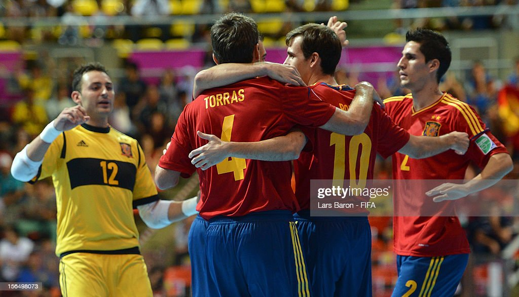 Torras of Spain celebrates with team mates during the FIFA Futsal World Cup SemiFinal match between Italy and Spain at Indoor Stadium Huamark on...