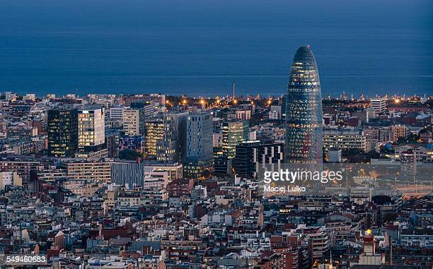 Torre Agbar and Barcelona skyline at night