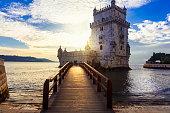 Torre de Belem over sunset - famous landmark of Lisbon , Portugal
