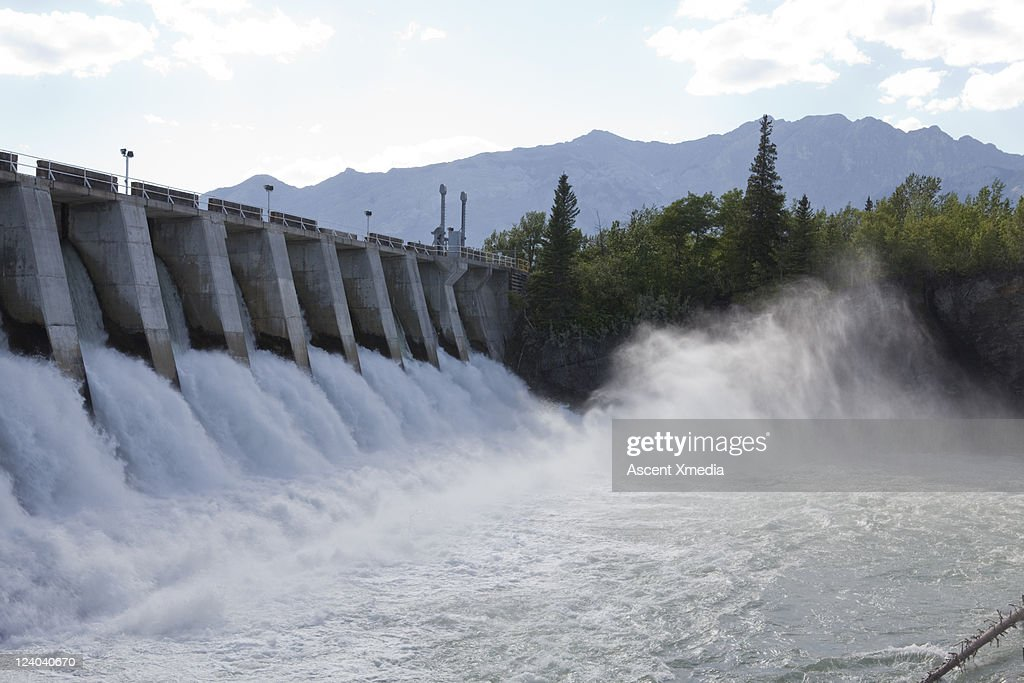 Torrent of water pours beneath hydroelectric dam
