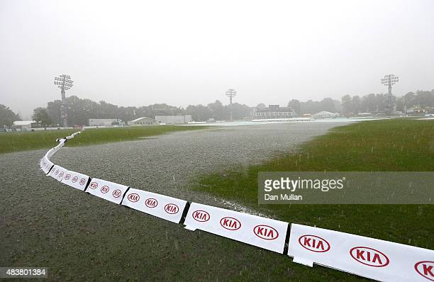 Torrential rain falls as large puddles of water collect on the outfield during day three of the Kia Women's Test of the Women's Ashes Series between...